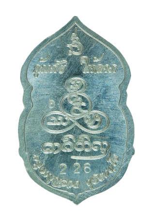 Small Buddha image or Thai amulet isolated on white background. / Buddha Medal isolated on white background.