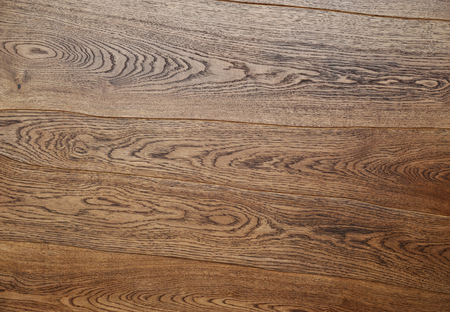 the row: Applying protective varnish on a wooden furniture