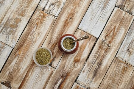 mate infusion: calabash on wooden tabel