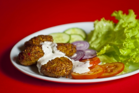 kebab: Traditional turkish meat ball served on white plate with vegetable mix