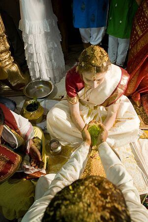 Preparation of european bride to traditional indian wedding photo