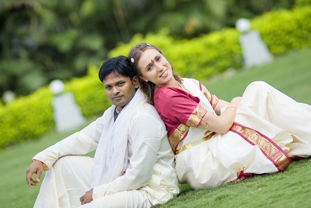 International couple married according to indian traditions photo