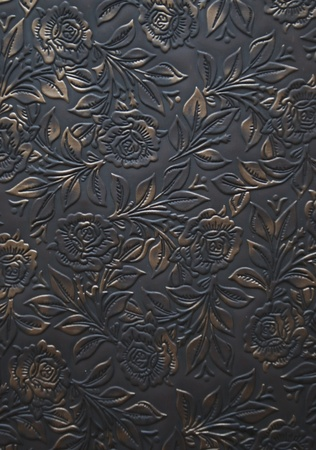 Floral ornament embosed on leather - decoration photo