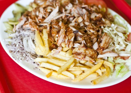 doner: Traditional turkish doner kebab served on white plate with potatoes