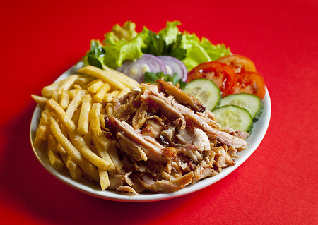 Traditional turkish doner kebab in bread served on white plate Stock Photo