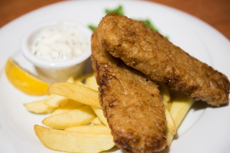 english food: Traditional English food - Fish and chips served on 3hite plate