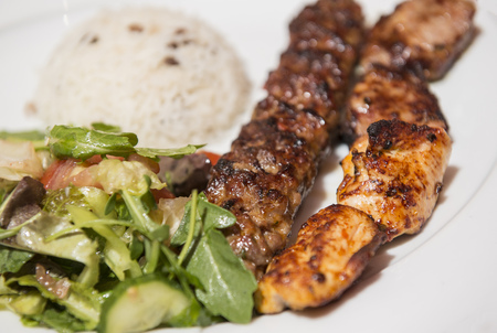 Turkish Traditional Skewer Chicken and Lamb Kebab served with rice and vegetables Stock Photo