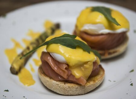 poach: Delicious eggs benedict with smoked salmon and hollandaise sauce served on wholegrain bun bread