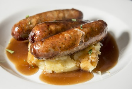 Bangers with mash - sausages with gravy and mashed potatoes