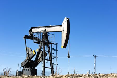 View of Oil Well Pumpjack (Horsehead) at Daylight Oil Industry Stock Photo