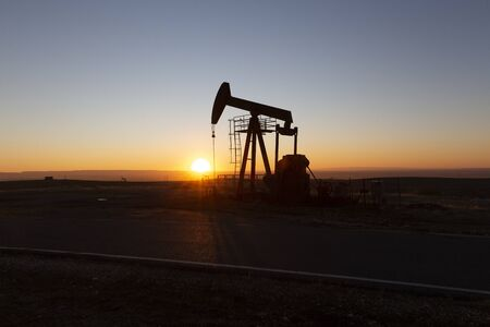 View of Oil Well Pumpjack (Horsehead) at Sunset Oil Industry