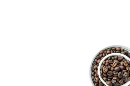 invigorate: White background with grain coffee in cup in the corner