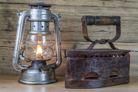 flatiron: Aging oil Lamp and flatiron Stock Photo