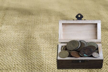 coffer: Wooden coffer with coin Stock Photo