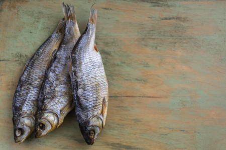 Dried fish on wooden background Stock Photo