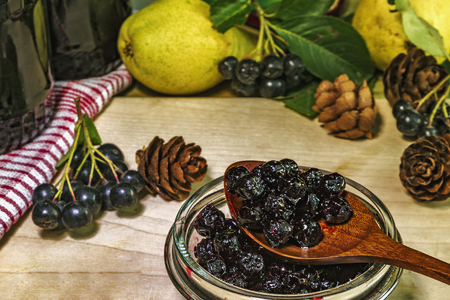 Black chokeberry jam and fruit