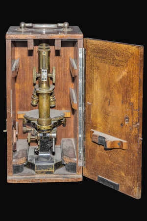 Vintage microscope in wooden case Stock Photo