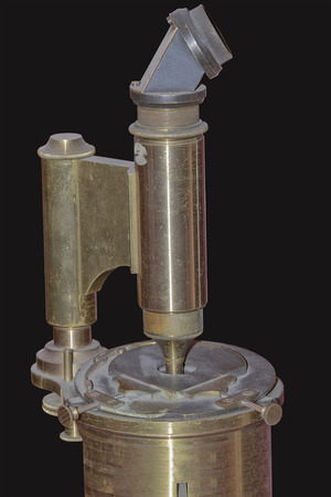 fragment of a vintage microscope