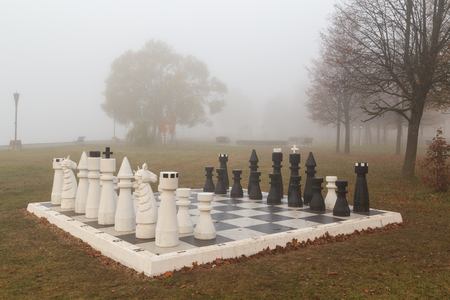 Autumn, chess in the Park and fog