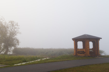 Autumn fog and gazebo