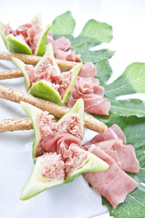 fast food - figs and prosciutto photo