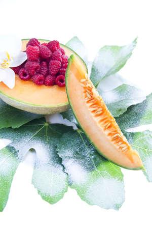 fruit - melon and raspberries photo