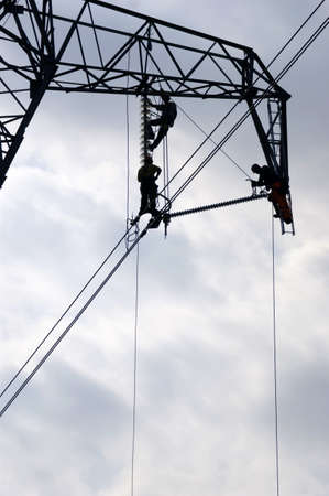 repairing a power line photo