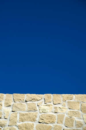 Stone Wall With Blue Sky In The Background photo