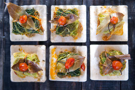 Presentation Of Tile Marl, Bundle Of Meat in Cabbage Leaves photo
