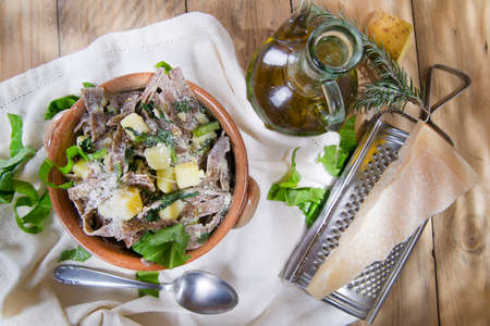 the grater: Typical dish of the Italian tradition, Pizzoccheri of buckwheat flour