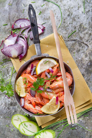 Preparation And Presentation 0f a Dish Of Raw Prawns photo