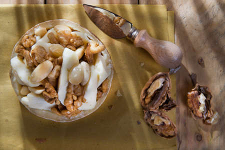 enriched: Food combination, sheeps cheese, walnuts and almonds Stock Photo