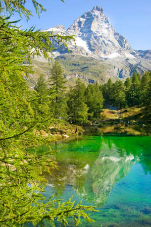 Aosta Valley View of Blue lake with reflection of Mount Matterhorn