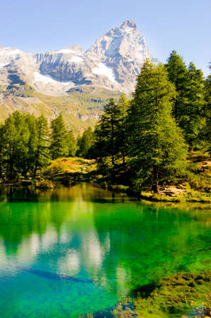 aosta: Aosta Valley View of Blue lake with reflection of Mount Matterhorn
