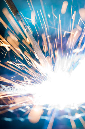 Welding operation performed by a worker in the workshop