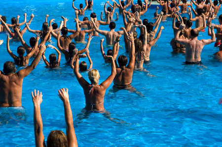 water aerobics: Time to get in shape by following water aerobics classes   Stock Photo