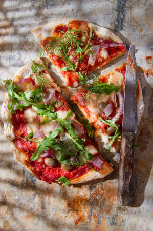 pizza base: Pizza base with whole wheat flour with arugula and onion    Stock Photo