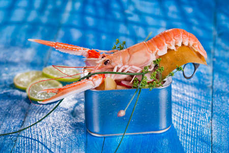 Presentation of a crustacean with mixed vegetables in box  Stock Photo