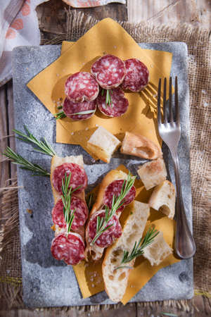 starchy food: Presentation of the typical focaccia and Tuscan salami