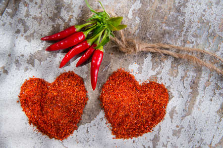 Presentation of two hearts made of chili powder Stock Photo