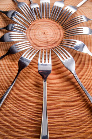 diferent: Series of different forks in a circle of pine board