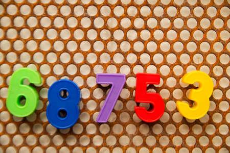 metal base: Series of numbers, 68753 on white base metal