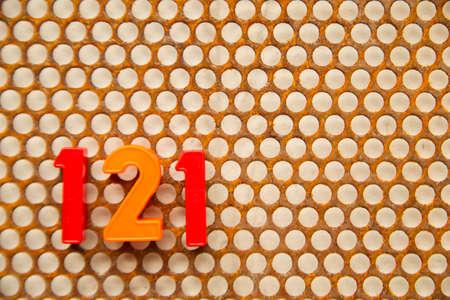 metal base: Series of numbers, 121 on white base metal