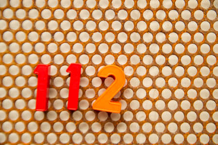 metal base: Series of letters and numbers on white base metal