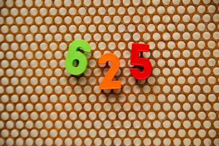 metal base: Series of numbers, 625 on white base metal