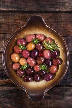 brine: Italian food, snack of olives in brine presented in flat Stock Photo