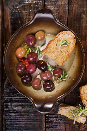 homemade bread: Snack of homemade bread and black olives in brine Stock Photo