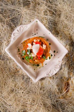 spaghetti sauce: Presentation in flat nest of spaghetti sauce full of scallops Stock Photo