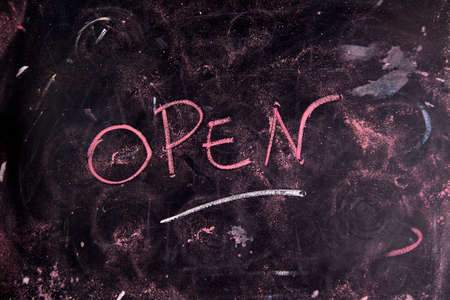 openness: Written graphic opening, with colorful chalk on blackboard Stock Photo