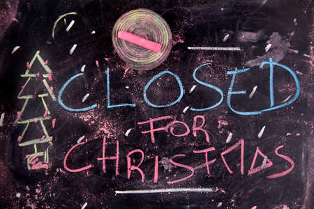 Graphic representation with chalk on blackboard written closed for Christmas